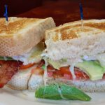 7) Breakfast Sandwich – Two eggs, bacon or ham, tomatoes and cheese